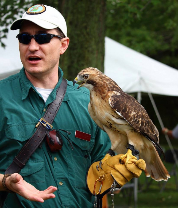 Chris and Cedar giving a hawk talk at Hawkfest 2015